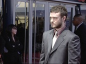 Pan up Justin Timberlake on red carpet at Brit Awards, London; 17 February 2004