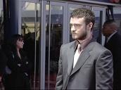 Pan up Justin Timberlake on red carpet at Brit Awards, London; 17 February 2004
