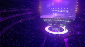 Zoom in on stage at Royal Albert Hall as Robbie Williams performs \%27Feel\%27 as models parade on circular catwalk, Fashion Rocks, London; 15 October 2003