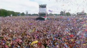 Ticker tape falling over crowd as Enrique Iglesias performs \%27La Bamba\%27, Party in the Park, Hyde Park; 7 July 2002