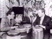 Marlon Brando plays bongos with Jack Costanzo in basement of Brando\%27s home, Los Angeles; 01 Apr 55
