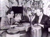 Marlon Brando plays bongos with Jack Costanzo in basement of Brando\%27s home, Los Angeles; 01 Apr 55