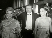 Actor Sean Connery steps from car accompanied by Hollywood star Rita Hayworth and actress Claudine Auger ahead of film premiere, Vienna; May 66