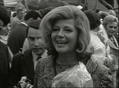 Crowds of press are held back as Hollywood actress Rita Hayworth steps off aircraft at Vienna airport; May 66