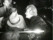 Zsa Zsa Gabor and family exit car and enter Hotel Sacher surrounded by fans and photographers, Vienna; Oct 58