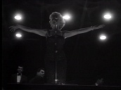 Marilyn Monroe performs for US troops at night, Korea; Feb 54