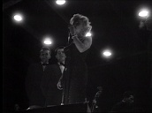 Marilyn Monroe performs with backing singers for US troops, Korea; Feb 54