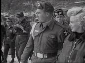 Military Police escort Marilyn Monroe through US army base, Korea; Feb 54
