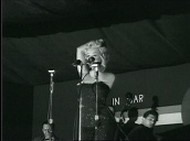 Marilyn Monroe performs at night in front of US troops, Korea; Feb 54