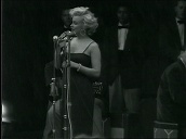 Marilyn Monroe performs in front of US troops before leaving stage, Korea; Feb 54