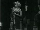 Marilyn Monroe performs in front of US troops before leaving stage, Korea; Feb 54
