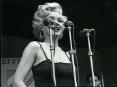 Marilyn Monroe enters stage and waves before performing in front of US troops, Korea; Feb 54