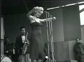 Marilyn Monroe wiggles her hips as she performs on stage for US troops, Korea; Feb 54