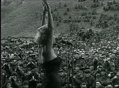 Marilyn Monroe performs on stage in front of large crowd of US troops, Korea; Feb 54