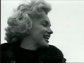 Marilyn Monroe waves to US troops before climbing into army jeep during entertainment tour, Korea; Feb 54